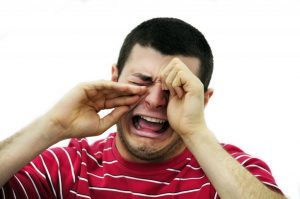 Man crying over him scuffing his alloy wheels on a curb